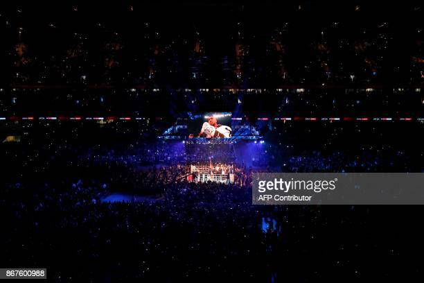 TOPSHOT A general view of the stadium as Britain's Anthony Joshua enters the ring ahead of his world heavyweight title fight against challenger...