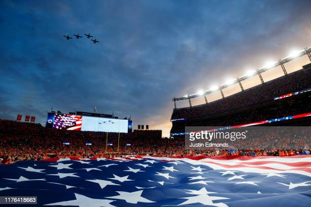 A general view of the stadium as planes fly over during the National Anthem before a game between the Kansas City Chiefs and Denver Broncos at...