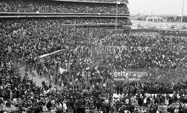 General view of the stadium as the fans storm the field and scoop up grass and souvenirs in celebration after Game 5 of the World Series on October...