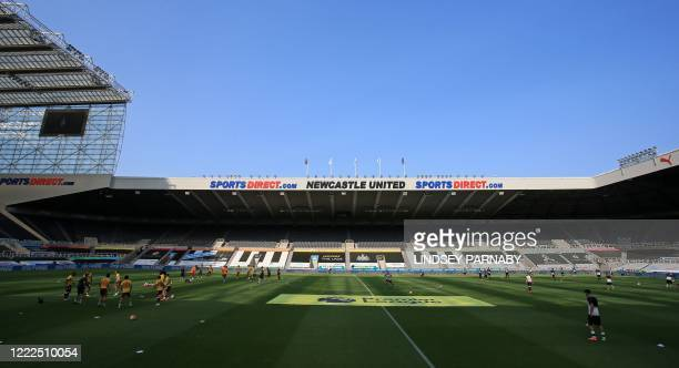 General view of the stadium as the players warm up ahead of the English Premier League football match between Newcastle United and Aston Villa at St...