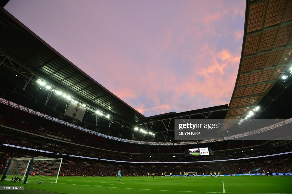 A general view of the stadium at sunset is seen during the English Premier League football match between Tottenham Hotspur and Watford at Wembley Stadium in London, on April 30, 2018. (Photo by Glyn KIRK / AFP) / RESTRICTED TO EDITORIAL USE. No use with unauthorized audio, video, data, fixture lists, club/league logos or 'live' services. Online in-match use limited to 75 images, no video emulation. No use in betting, games or single club/league/player publications. /