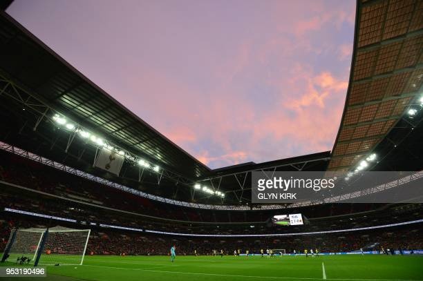 A general view of the stadium at sunset is seen during the English Premier League football match between Tottenham Hotspur and Watford at Wembley...