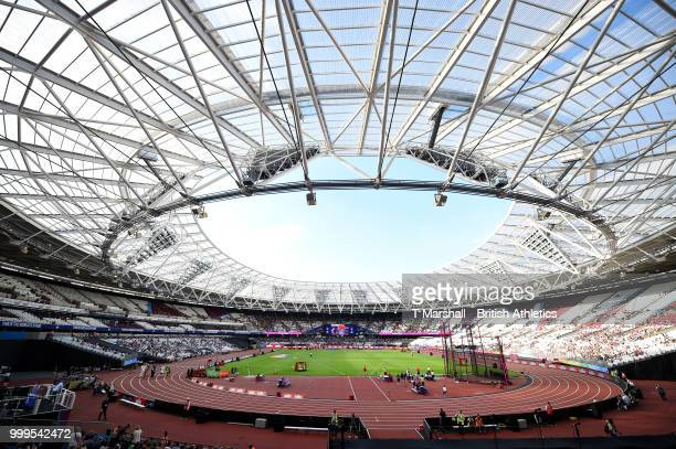 Captain Queen Harrison and Courtney Okolo lift the trophy as Team USA celebrate victory during day two of the Athletics World Cup London at the...