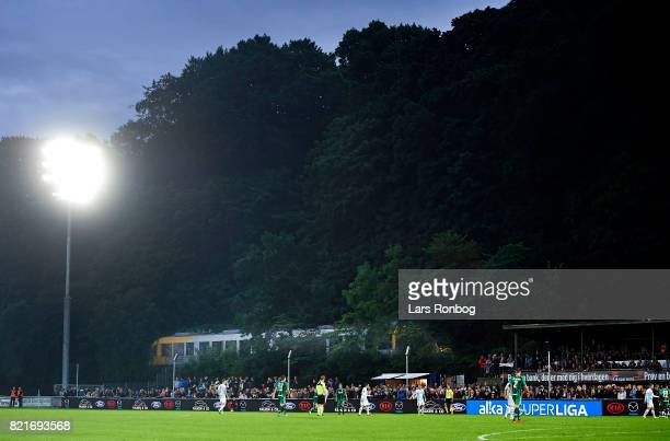 General view of the stadium, the pitch and a train during the Danish Alka Superliga match between FC Helsingor and OB Odense at Helsingor Stadion on...