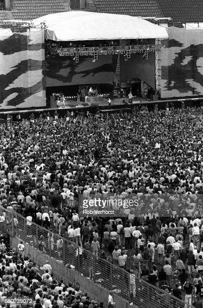 General view of the stage and the audience in the stadiume watching U2 perform during The Joshua Tree Tour, Feyenoord Stadion, De Kuip, Rotterdam,...