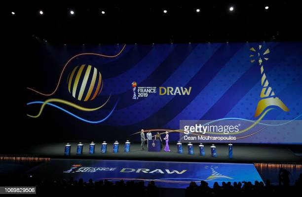 General view of the stage as Louis Saha and Alex Scott talk to draw hosts Denis Brogniart and Amanda Davies during the FIFA Women's World Cup France...