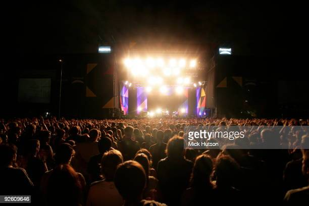 A general view of the stage at a large outdoor arena showing stage lights and the backs of the audience heads as they watch a Keane concert at Club...