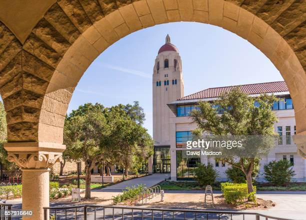 A general view of the Stanford University campus showing the Hoover Tower and the Hoover Institute through an arch of the Main Quadrangle buildings...