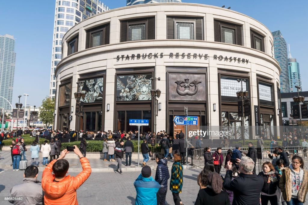 General view of the Starbucks Reserve Roastery outlet in Shanghai on December 6, 2017. Starbucks opened its largest cafe in the world in Shanghai on December 6 as the US-based beverage giant bets big on the burgeoning coffee culture of a country traditionally known for tea-drinking. / AFP PHOTO / - / China OUT