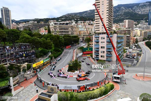 General view of the start at the Fairmont Hairpin showing Charles Leclerc of Monaco driving the Scuderia Ferrari SF90 and Lando Norris of Great...