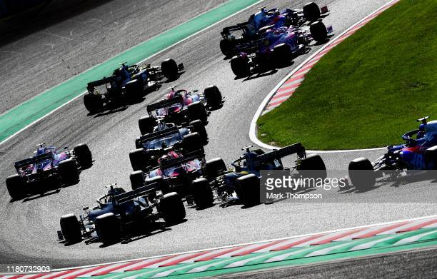 A general view of the start showing Pierre Gasly of France driving the Scuderia Toro Rosso STR14 Honda leading Lance Stroll of Canada driving the...