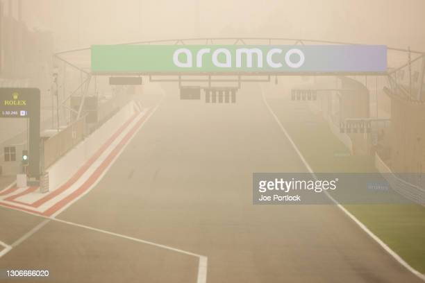 General view of the start/finish straight during a sandstorm during Day One of F1 Testing at Bahrain International Circuit on March 12, 2021 in...