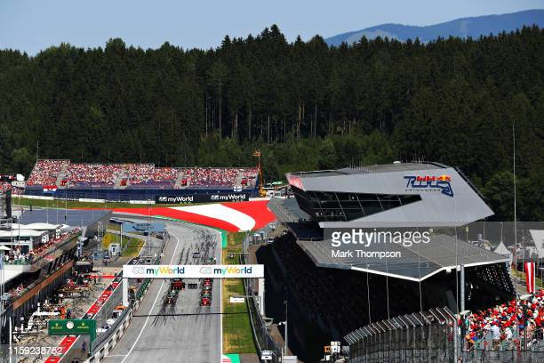 A general view of the starting grid showing Formula One driver Charles Leclerc of Monaco driving the Scuderia Ferrari SF90 and Max Verstappen of the...