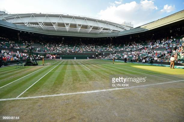 A general view of the state of the grass on centre court on the final day of the 2018 Wimbledon Championships at The All England Lawn Tennis Club in...