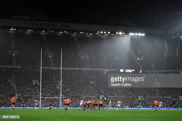 General View of the Stretford End and the match in action as rain falls during the Betfred Super League Grand Final match between Castleford Tigers...
