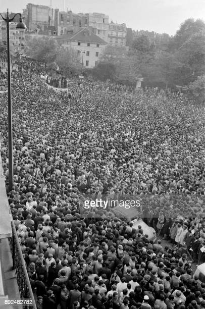 General view of the student demonstration Place Denfert Rochereau while the 2CV of the Red Cross is spawning a passage in the crowd on May 7 1968 in...