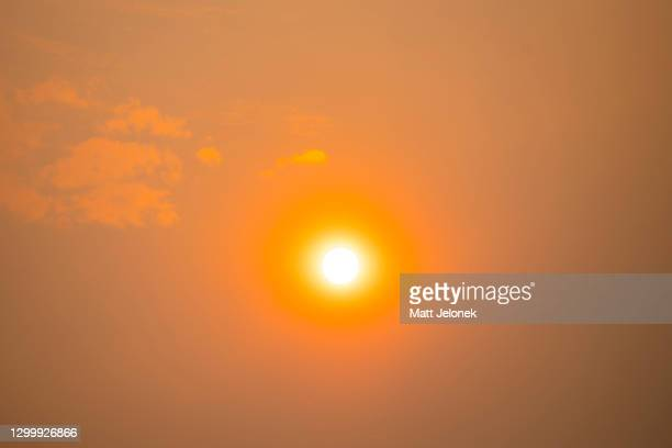 General view of the sun with smoke haze on February 2, 2021 in Perth, Australia. Up to 30 homes are feared lost as firefighters continue to work to...
