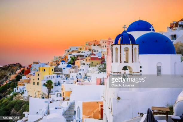 A general view of the sunset in the picturesque village of Oia on Santorini Island on August 12 2017 in Mykonos Greece