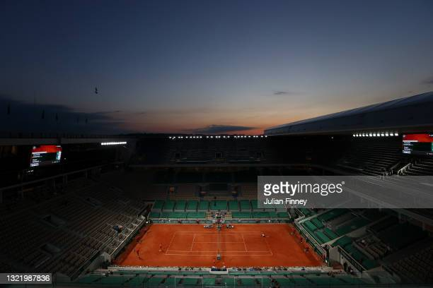 General view of the sunset over Court Philippe-Chatrier as Dominik Koepfer of Germany serves during his Men's Singles third round match against Roger...