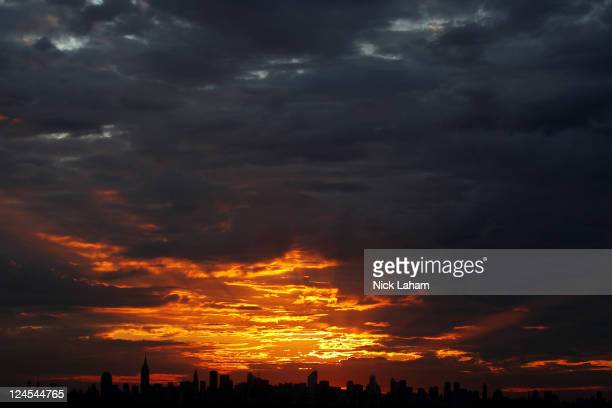 A general view of the sunset over the New York City skyline is seen from the grounds of the USTA Billie Jean King National Tennis Center during Day...