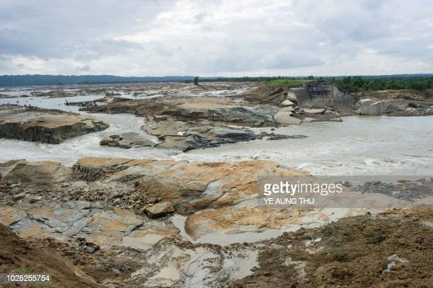 A general view of the Swar Chaung dam with water draining out from the broken spillway partly seen at right at Swar township Bago region on August 30...