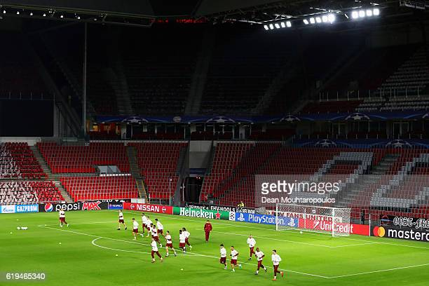 A general view of the team as they warm up during the Bayern Muenchen training session held at Philips Stadium on October 31 2016 in Eindhoven...