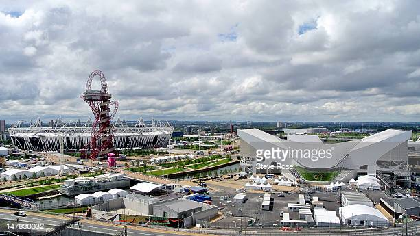 A general view of the the ArcelorMittal Orbit sculpture standing in front of the Olympic Stadium with the Aquatics Centre to the right in the Olympic...