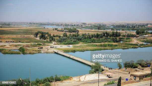 A general view of the Tigris River is seen from the compound of the closed Nineveh International Hotel in Mosul on June 16 2017 which was recovered...
