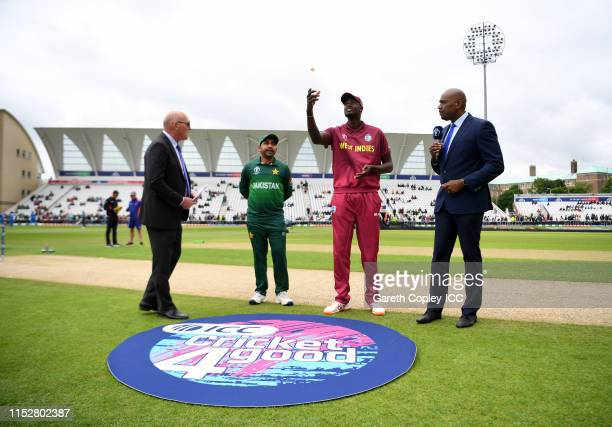 General view of the toss as Jason Holder of West Indies flicks the coin during the Group Stage match of the ICC Cricket World Cup 2019 between West...
