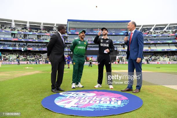 General view of the toss as Kane Williamson of New Zealand flips the coin during the Group Stage match of the ICC Cricket World Cup 2019 between New...