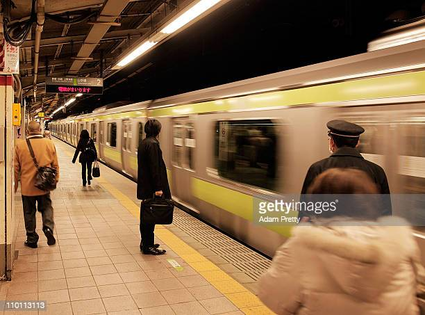 A general view of the train platform at Harajuku Station as a train arrives almost deserted during peak hour after an 90 magnitude strong earthquake...