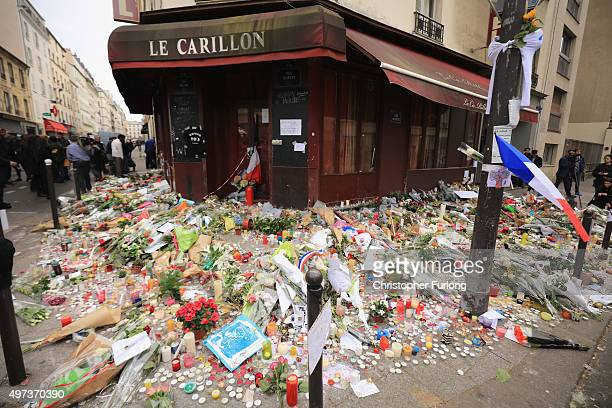 A general view of the tributes outside the Le Carillon restaurant one of the scenes of last friday's terror attacks on November 16 2015 in Paris...