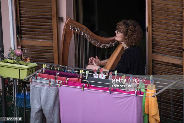 General view of the Turin Musician Federica Magliano during the Flash Mob Italian Sound for the coronavirus decree on the Italy Clamps Down On Public...
