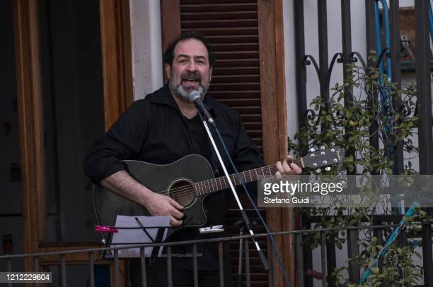 General view of the Turin Musician Federico Sirianni during the Flash Mob Italian Sound for the coronavirus decree on the Italy Clamps Down On Public...