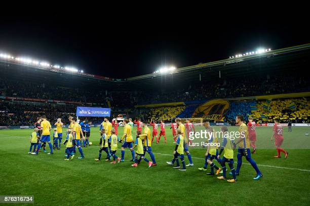 General view of the two teams and a fans tifo walking on to the pitch prior to the Danish Alka Superliga match between Brondby IF and FC Nordsjalland...