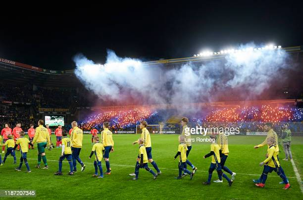 General view of the two teams walking on to the pitch and pyrotechnics from the fans prior to the Danish 3F Superliga match between Brondby IF and FC...
