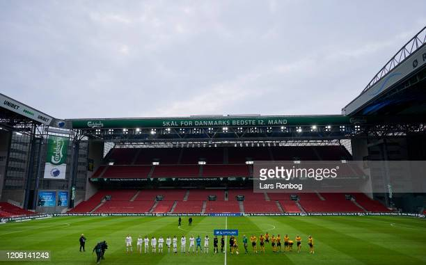 General view of the two teams walking on to the pitch in the empty stadium because of the Corona COVID19 virus infection prior to to the Danish 3F...