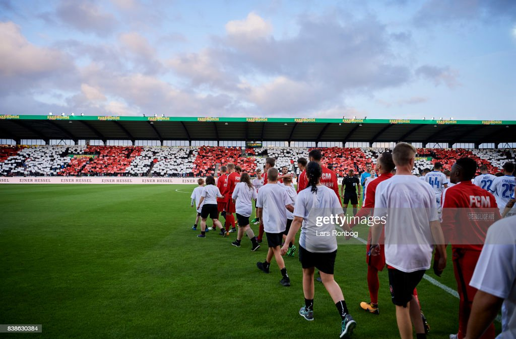 General view of the two teams walking on to the pitch prior to the UEFA Europa League Playoff 2nd Leg match between FC Midtjylland and Apollon Limassol at MCH Arena on August 24, 2017 in Herning, Denmark.