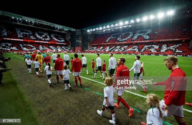 General view of the two teams walking on to the pitch prior to the FIFA 2018 World Cup Qualifier PlayOff First Leg match between Denmark and Republic...
