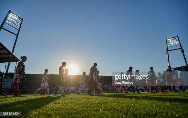 General view of the two teams walking on to the pitch prior to the Danish Alka Superliga match between AaB Aalborg and FC Copenhagen at Aalborg...
