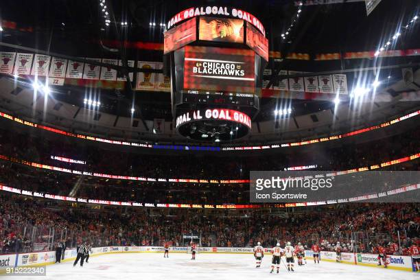 A general view of the United Center and the jumbotron after the Chicago Blackhawks scored a goal is seen during a game between the Chicago Blackhawks...