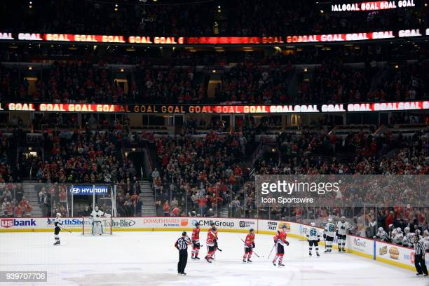 A general view of the United Center as Chicago Blackhawks players and fans celebrate after a goal is scored in action during a game between the...
