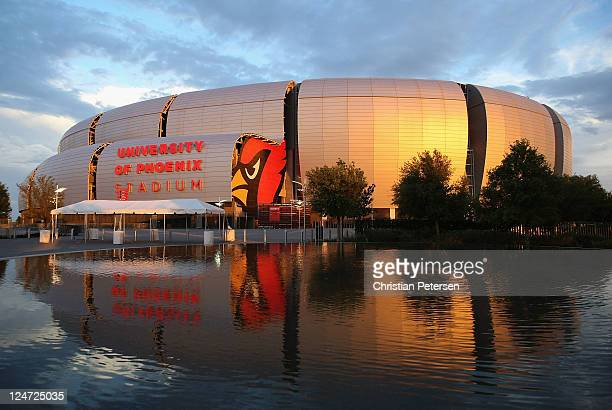 General view of the University of Phoenix Stadium as the sun sets following the NFL season opener game between the Carolina Panthers and the Arizona...