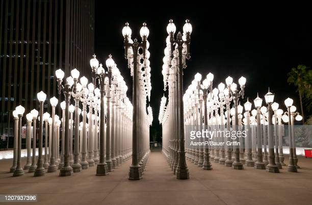 A general view of the 'Urban Light' art installation at LACMA Normally busy on Saturday nights with tourists couples and photographers the sculpture...