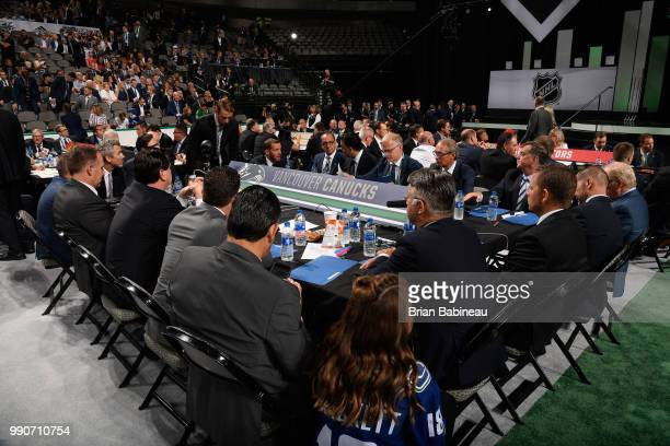 A general view of the Vancouver Canucks draft table is seen during the first round of the 2018 NHL Draft at American Airlines Center on June 22 2018...