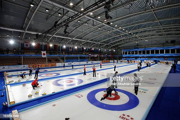 A general view of the venue as Satsuki Fujisawa of Japan throws the stone in the match between Japan and Latvia in the closest area of play during...