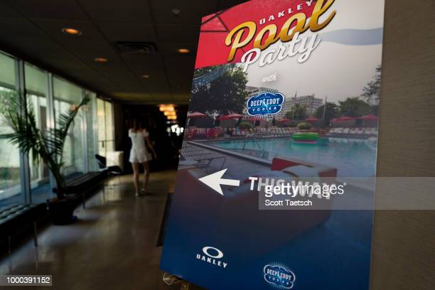 Chris Rose and Kevin Millar watch Torii Hunter play cornhole at the Oakley Pool Party Featuring Deep Eddy Vodka at Capitol Skyline Hotel Pool on July...