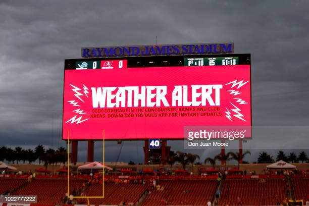 General view of the video board in Raymond James Stadium warning fans and teams to take cover because of bad weather before the start of a preseason...