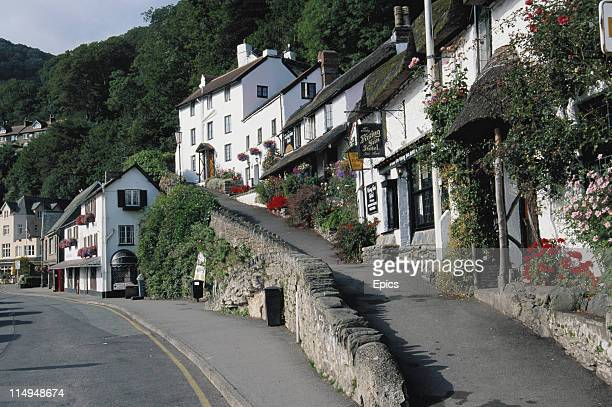 A general view of the village of Lynmouth including the 14th century thatched building of the Rising Sun Hotel Lynmouth Devon July 1997