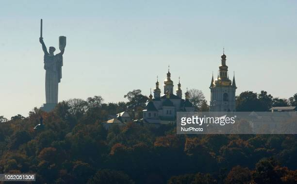 General view of the Vydubychi Monastery next to Mother of the Fatherland monument in Kiev, Ukraine, on 13 October 2018. In Istanbul, under the...